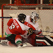 Martin Nikolov, Bulgaria, scores a penalty past Turkish Goal Tender Fikri Atali during the Turkey V Bukgaria match during the 2012 IIHF Ice Hockey World Championships Division 3 held at Dunedin Ice Stadium. Dunedin, Otago, New Zealand. 21st January 2012. Photo Tim Clayton