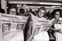 OF0011145 - women reading headlines when Nixon resigned, at Washington National Airport