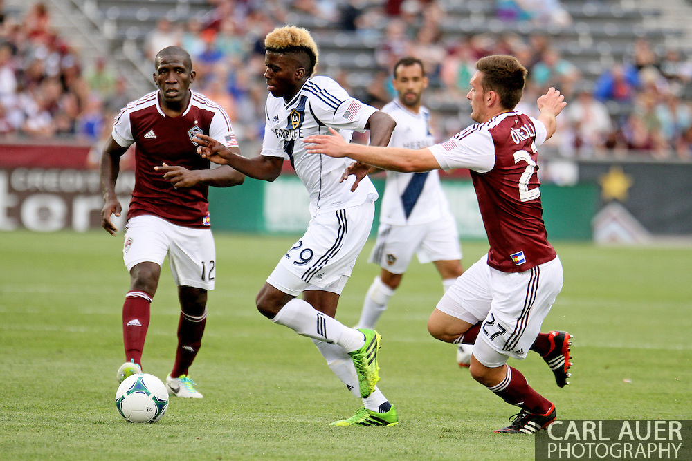July 27th, 2013 - LA Galaxy forward Gyasi Zardes (29) attempts to take the ball past Colorado Rapids midfielder Shane O'Neill (27) in the second half of the Major League Soccer match between the LA Galaxy and the Colorado Rapids at Dick's Sporting Goods Park in Commerce City, CO