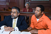 Lawyer and criminal sitting in court