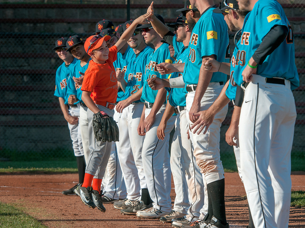 em060917i/jnorth/Jason Bowen and his Little League baseball team get to meet the Santa Fe Fuego and take the field with them for the National Anthem before the start of a game at Fort Marcy Field Santa Fe, Friday June 9, 2017.  (Eddie Moore/Albuquerque Journal)