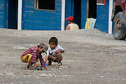 Two children play with toy cars on the Interoceanic Highway