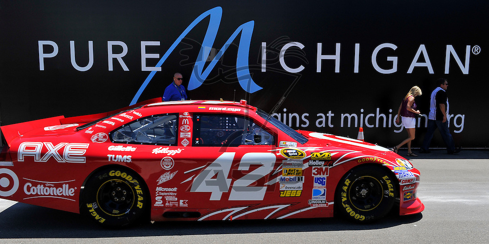 Brooklyn, MI - JUN 15, 2012: Juan Pablo Montoya (42)  drives into the garage during practice for the Quicken Loans 400 race at the Michigan International Speedway in Brooklyn, MI.