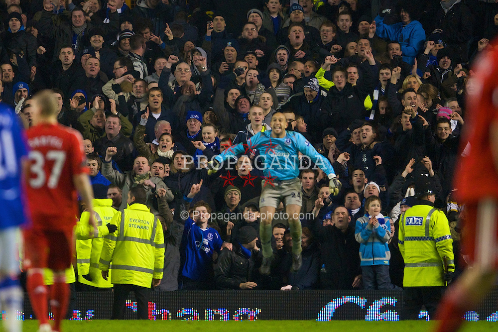 LIVERPOOL, ENGLAND - Wednesday, February 4, 2009: Everton's goalkeeper Tim Howard celebrates with the fans during the FA Cup 4th Round Replay match against Liverpool at Goodison Park. (Mandatory credit: David Rawcliffe/Propaganda)