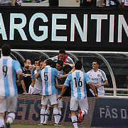 Lionel Messi, Argentina, celebrates his hat trick with team mates during the Brazil V Argentina International Football Friendly match at MetLife Stadium, East Rutherford, New Jersey, USA. 9th June 2012. Photo Tim Clayton