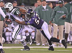 Sept 13, 2011; East Rutherford, NJ, USA; Baltimore Ravens linebacker Ray Lewis (52) tackles New York Jets running back Tony Richardson (49) during the second half at the New Meadowlands Stadium.  The Ravens defeated the Jets 10-9.