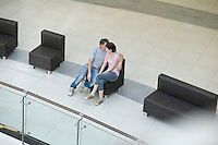 Young couple sit together in new shopping mall Voronezh
