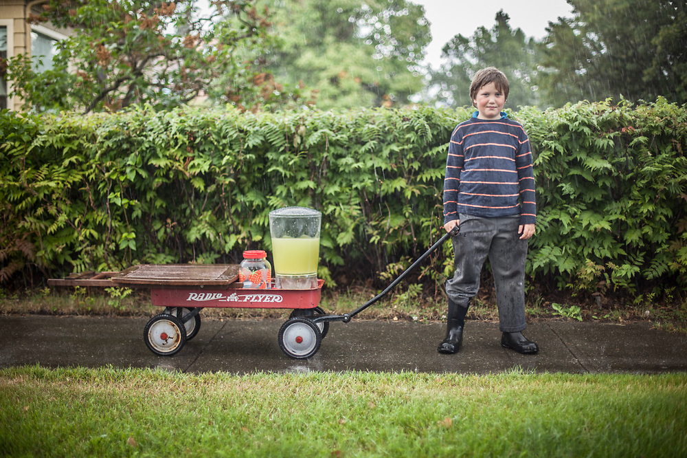 """""""I'll try again tomorrow.""""  -Neighbor Camper Pillifant leaves the Delaney Park Strip with his lemonaid stand during an abrupt storm."""