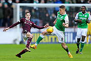 Harry Cochrane (#47) of Heart of Midlothian contests teh ball in the air with Vykintas Slivka (#8) of Hibernian during the William Hill Scottish Cup 4th round match between Heart of Midlothian and Hibernian at Tynecastle Stadium, Gorgie, Scotland on 21 January 2018. Photo by Craig Doyle.