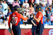 Jason Roy of England and Jos Buttler of England touch gloves during the International T20 match between England and India at the SWALEC Stadium, Cardiff, United Kingdom on 6 July 2018. Picture by Graham Hunt.