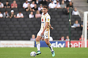 Milton Keynes Dons midfielder (on loan from Chelsea) Jordan Houghton (24) looks to release the ball during the EFL Sky Bet League 2 match between Milton Keynes Dons and Grimsby Town FC at stadium:mk, Milton Keynes, England on 21 August 2018.