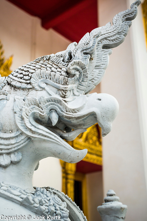 "12 APRIL 2014 - BANGKOK, THAILAND:  A ""naga"" in front of the temple at the National Museum in Bangkok. A ""naga"" is a mythical serpent that protects temples. The Phra Buddha Sihing, a revered statue of the Buddha, is carried by truck through the streets of Bangkok so people can make offerings and bathe it in scented oils. Songkran is celebrated in Thailand as the traditional New Year's from 13 to 16 April. The date of the festival was originally set by astrological calculation, but it is now fixed. The traditional Thai New Year has been a national holiday since 1940, when Thailand moved the first day of the year to January 1. The first day of the holiday period is generally the most devout and many people go to temples to make merit and offer prayers for the new year.      PHOTO BY JACK KURTZ"