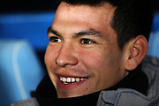 Hirving Lozano of Napoli laughs on the bench before the UEFA Champions League, Group E football match between SSC Napoli and KRC Genk on December 10, 2019 at Stadio San Paolo in Naples, Italy - Photo Federico Proietti / ProSportsImages / DPPI