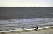 Nederland, the Netherlands,  27-3-2016Vanaf de kust, strand, zijn de windturbines van een windpark op zee goed te zien. Een regenbui trekt juist langs. Het windpark Egmond aan Zee is het eerste grote windpark dat in de Noordzee voor de Nederlandse kust is gebouwd. Het park bestaat uit 36 windmolens met ieder een vermogen van 3 MW. Samen leveren zij duurzame elektriciteit voor meer dan 100.000 huishoudens.FOTO: FLIP FRANSSEN