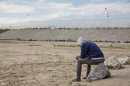 Calais, Pas-de-Calais, France - 16.10.2016    <br />     <br />  Several high fences block the way towards the port and Euro Tunnel. &rdquo;Jungle&quot; refugee camp on the outskirts of the French city of Calais. Many thousands of migrants and refugees are waiting in some cases for years in the port city in the hope of being able to cross the English Channel to Britain. French authorities announced that they will shortly evict the camp where currently up to up to 10,000 people live.<br /> <br />  Unter anderem mehrere hohe Zaeune versperren die Wege Richtung Hafen und Eurotunnel. &rdquo;Jungle&rdquo; Fluechtlingscamp am Rande der franzoesischen Stadt Calais. Viele tausend Migranten und Fluechtlinge harren teilweise seit Jahren in der Hafenstadt aus in der Hoffnung den Aermelkanal nach Gro&szlig;britannien ueberqueren zu koennen. Die franzoesischen Behoerden kuendigten an, dass sie das Camp, indem derzeit bis zu bis zu 10.000 Menschen leben K&uuml;rze raeumen werden. <br /> <br /> Photo: Bjoern Kietzmann