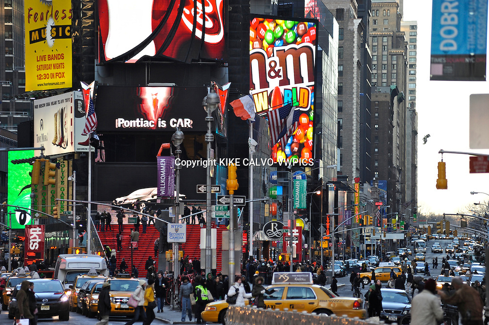 People visiting New York soon forget to look up, and appreciate the beauty and complexity of the architectonic details of its buildings, contructions and skyscrappers.Pictured: Busy life in Times Square. Neon lights, ads and theater district.