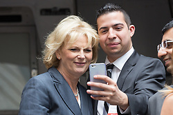 © Licensed to London News Pictures. 23/06/2015. London, UK. ANNA SOUBRY poses for a selfie with an entrepreneur at the launch of the Start-Up Britain campaign routemaster bus in Downing Street, London with Prime Minister, David Cameron. Over five weeks the routemaster bus will visit 30 towns and cities - including Aberdeen, Inverness, Swansea York and Leeds - and aim to engage with 15,000 individuals through workshops and networking events, making them aware of the assistance Start-Up Britain can offer. Photo credit : Vickie Flores/LNP