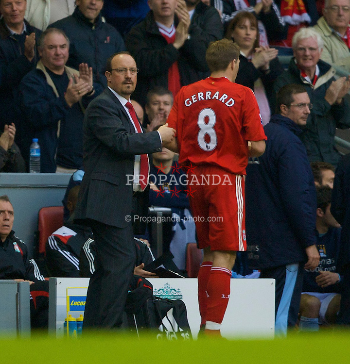 LIVERPOOL, ENGLAND - Sunday, May 4, 2008: Liverpool's captain Steven Gerrard MBE is congratulated by manager Rafael Benitez as he is substituted during the Premiership match at Anfield. (Photo by David Rawcliffe/Propaganda)