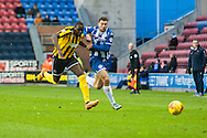 Yanic Wildschut of Wigan Athletic and Jermaine Grandison of Shrewsbury Town challenge for the ball during the Sky Bet League 1 match at the DW Stadium, Wigan<br /> Picture by Matt Wilkinson/Focus Images Ltd 07814 960751<br /> 21/11/2015