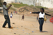 Emmanuel Kwaku Yeboah takes pictures of his girlfriend Doris Morrison Amankwaa on the beach in Cape Coast, Ghana on Sunday September 7, 2008. The couple was visiting to attend the Oguaa Fetu Afahye Festival, held annually in the coastal town.