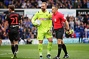 Referee Stephen Martin shares a joke with Bolton Wanderers goalkeeper Ben Alnwick (1) during the EFL Sky Bet Championship match between Ipswich Town and Bolton Wanderers at Portman Road, Ipswich, England on 22 September 2018.