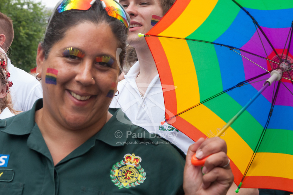 Brighton, August 2nd 2014. A Paramedic displays her colours during Brighton Pride.