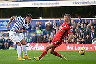 Eduardo Vargas of Queens Park Rangers with a volley shot at goal. Barclays Premier league match, Queens Park Rangers v Leicester city at Loftus Road in London on Saturday 29th November 2014.<br /> pic by John Patrick Fletcher, Andrew Orchard sports photography.