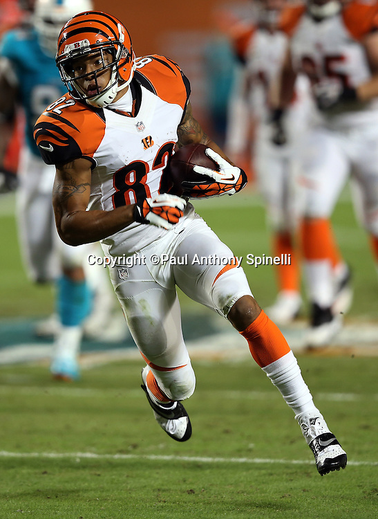 Cincinnati Bengals wide receiver Marvin Jones (82) catches a pass and runs for a 50 yard touchdown nullified by an offensive holding penalty during the NFL week 9 football game against the Miami Dolphins on Thursday, Oct. 31, 2013 in Miami Gardens, Fla.. The Dolphins won the game 22-20 in overtime. ©Paul Anthony Spinelli