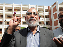 60371221 <br /> File photo taken on May 24, 2012 shows General Guide of Egypt's Muslim Brotherhood Mohamed Badie at a polling station during the presidential election in Beni Suef, Egypt. Mohamed Badie was arrested by police in Cairo, official news agency MENA reported early Tuesday,  August 20, 2013 citing a security source. <br /> Picture by imago / i-Images<br /> UK ONLY