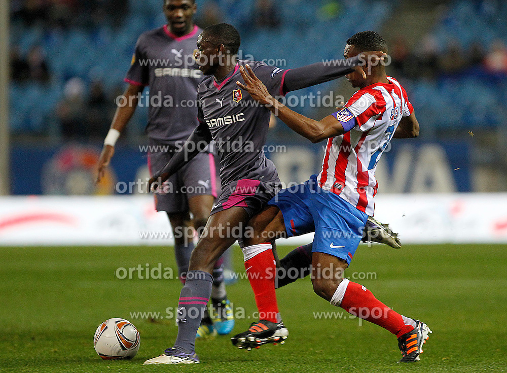15.12.2011, Vicente Calderon Stadion, Madrid, ESP, UEFA EL, Gruppe I, Atletico Madrid (ESP) vs Stade Rennes (FRA), im Bild  Atletico de Madrid's Luis Perea (l) and Stade Rennais' Dimitri Foulquier // during Europa League match.December 15,2011. (ALTERPHOTOS/Acero). EXPA Pictures © 2011, PhotoCredit: EXPA/ Alterphotos/ Acero..***** ATTENTION - OUT OF ESP and SUI *****