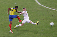 Antonio Valencia of Ecuador (L) shoots past Morgan Schneiderlin of France (saved) during the 2014 FIFA World Cup Group E match at Maracana Stadium, Rio de Janeiro<br /> Picture by Andrew Tobin/Focus Images Ltd +44 7710 761829<br /> 25/06/2014