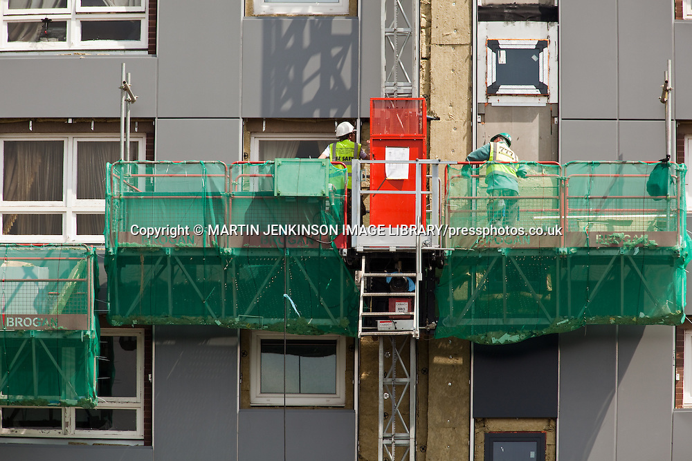 Camac mastclimbers on high rise flats in Sheffield during refurbishment part of the Decent Homes Programme.