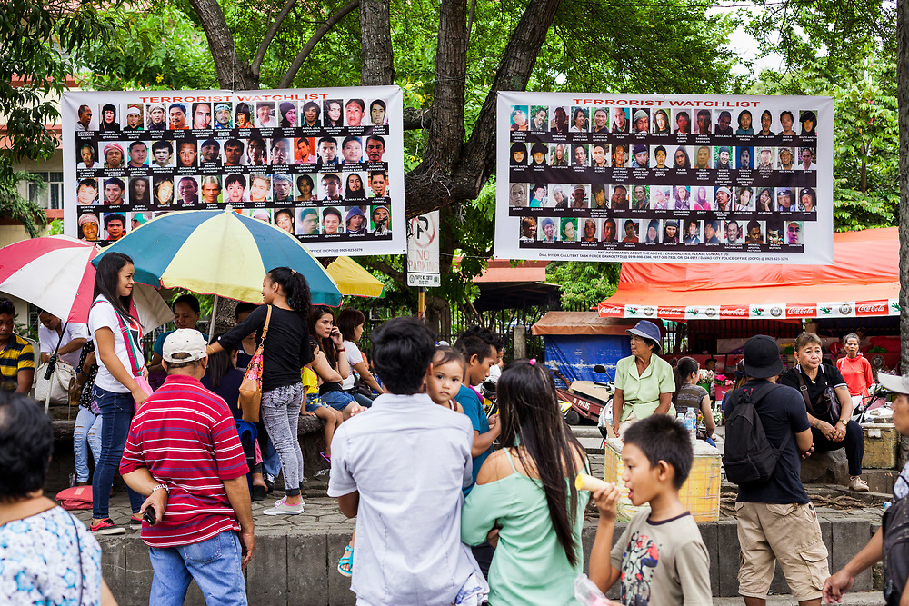 Davao City, Mindanao, Philippines - JUNE 18: Two large posters of Wanted Terrorist are seen posted across from San Pedro Cathedral.  On December 28, 1993,  San Pedro Cathedral was bombed during a Sunday evening mass killing seven and wounding 151.