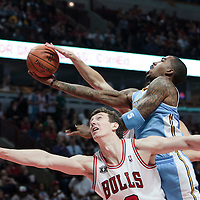 08 November 2010: Denver Nuggets' shooting guard #5 J.R. Smith goes to the basket over Chicago Bulls' center #3 Omer Asik during the Chicago Bulls 94-92 victory over the Denver Nuggets at the United Center, in Chicago, Illinois, USA.