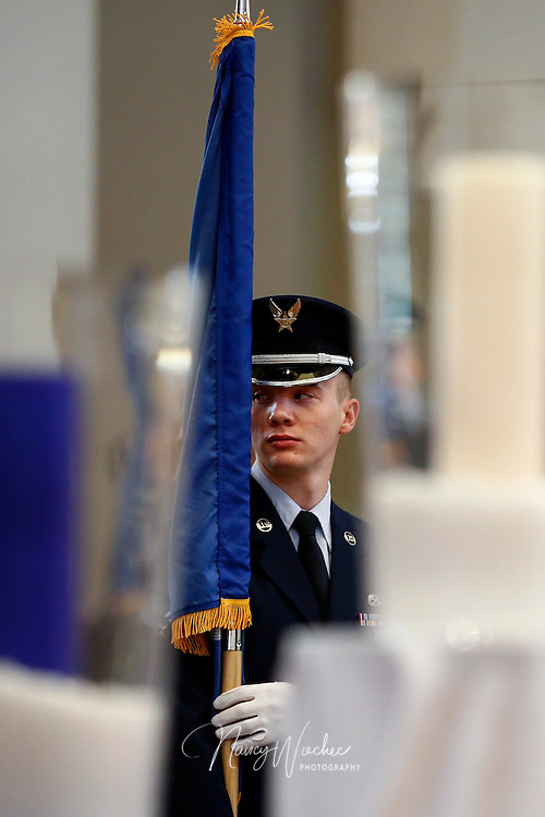 A member of an Air Force color guard takes part in the sixth annual Red, White and Blue Mass at St. Thomas Aquinas Church in Avondale, Ariz., Nov. 6. The Diocese of Phoenix marked the occasion to honor active and retired service men and women and to recall those who died in service to the country. (CNS photo/Nancy Wiechec)