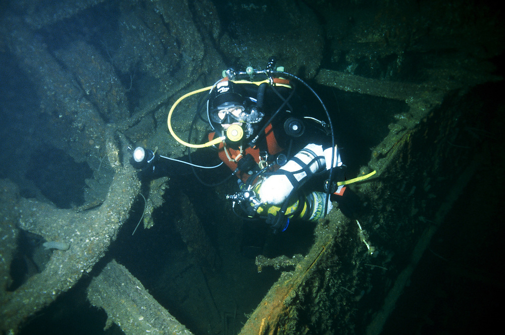 The wreck of the old steam boat D/S Sandeid lies on 50 metres of water. A trimix diver inspect port anchor. Location: Norway