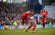Leyton Orient Midfielder Jobi McAnuff is fouled by Portsmouth defender Enda Stevens during the Sky Bet League 2 match between Portsmouth and Leyton Orient at Fratton Park, Portsmouth, England on 6 February 2016. Photo by Adam Rivers.