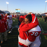 Smyrna players and coaches celebrate after defeating top seeded Salesianum 32-26 in the DIAA Division I championship game Saturday, Dec. 05, 2015 at Delaware Stadium in Newark.