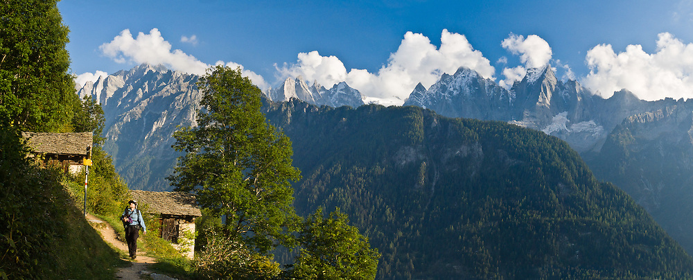 The rugged granite mountains of Sciora Group rise in the Bregaglia Range in Graubünden (Grisons) canton, Switzerland, the Alps, Europe. Sciora Dadent (or Sciora di Dentro) rises to 3275 meters (10,745 feet). Below Maloja Pass, walk from Cassacia (or Vicosoprano) to Soglio village (11 miles, 2000 feet up, 2900 feet down) on the Sentiero Panaramico, a signed scenic trail. Panorama stitched from 3 overlapping images.