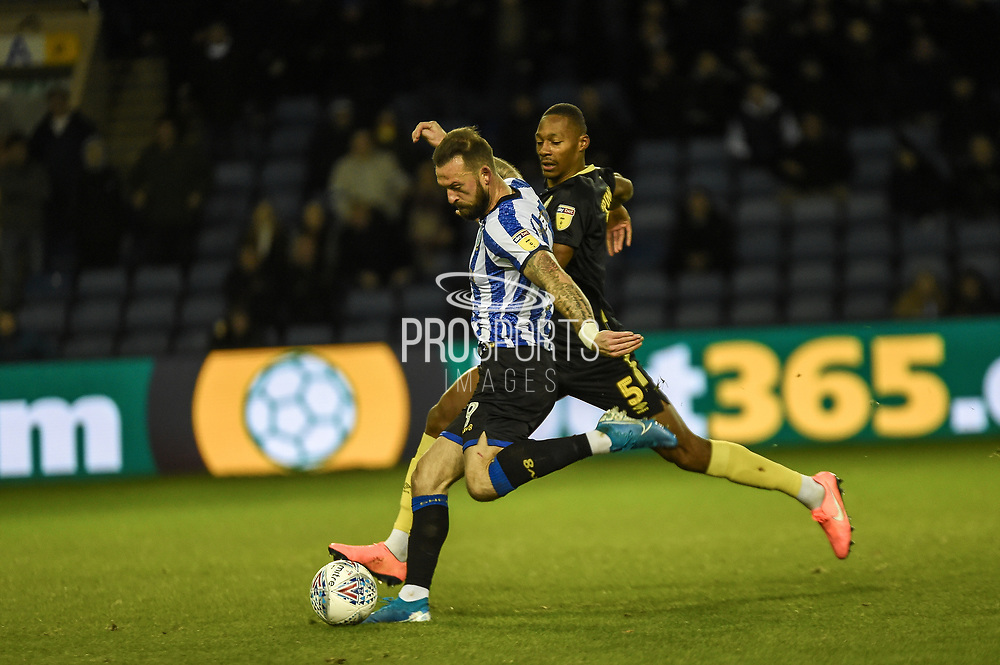 Steven Fletcher of Sheffield Wednesday good chance but shot is saved during the EFL Sky Bet Championship match between Sheffield Wednesday and Brentford at Hillsborough, Sheffield, England on 7 December 2019.