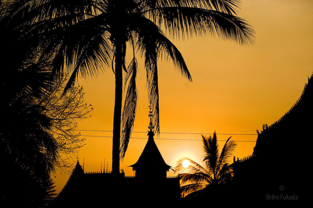 Sun sets at village outside of Dai Minority Park. Dai farmers grow rice and have rubber plantations in the hills. Even in the Dai park, most villagers still farm rubber for their primary income.