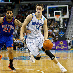 December 3, 2010; New Orleans, LA, USA; New Orleans Hornets power forward Jason Smith (14) drives past New York Knicks small forward Wilson Chandler (21) during the first half at the New Orleans Arena. Mandatory Credit: Derick E. Hingle