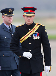 HONINGTON- UK - 13-NOV-2014- Prince Harry, Honorary Air Commandant, presents No 26 squadron RAF Regiment with a new standard at a parade at Royal Air Force Honington, Bury St Edmunds, Suffolk.<br />  <br /> The Prince inspected the No 26 Squadron RAF Regiment before taking his position on the dais for the parade. <br /> Photograph by Ian Jones