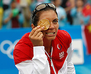 8/21/08 12:08:13 PM -- The 2008 Beijing Summer Olympics -- Beijing, China<br />  --  Misty May-Treanor jokes with photographers when asked to bite the medal during their Women's Beach Volleyball Gold Medal Ceremeoy  after beating China Thursday August 21, 2008  -- <br /> <br /> <br /> Photo by Jeff Swinger, USA TODAY Staff
