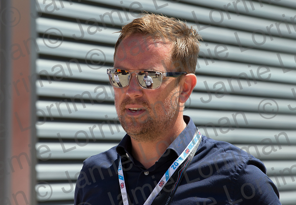 The 2018 Formula 1 F1 Rolex British grand prix, Silverstone, England. Sunday 8th July 2018.<br /> <br /> Pictured: Television presenter Simon Thomas in the paddock ahead of the race at Silverstone.<br /> <br /> Jamie Lorriman<br /> mail@jamielorriman.co.uk<br /> www.jamielorriman.co.uk<br /> 07718 900288