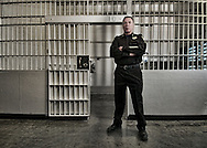 Meet your new cell service provider | Under-Sherriff Chris Cunnie stands in front of cell 10 in the San Francisco County Jail | June 29, 2010