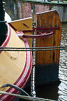Amsterdam, Holland. Close-up of a wooden rudder on a houseboat on a canal.