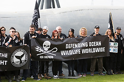 © Licensed to London News Pictures. 14/04/2016. London, UK. Demonstrators and supporters from Sea Shepherds protest with a giant whale outside the BP Annual General Meeting (AGM) being held at ExCel Centre in east London. Photo credit : Vickie Flores/LNP