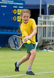 LIVERPOOL, ENGLAND - Wednesday, June 20, 2012: Children from local schools get a chance to have a hit on Calderstones Park's Centre Court during a kids' day at the Medicash Liverpool International Tennis Tournament. (Pic by David Rawcliffe/Propaganda)