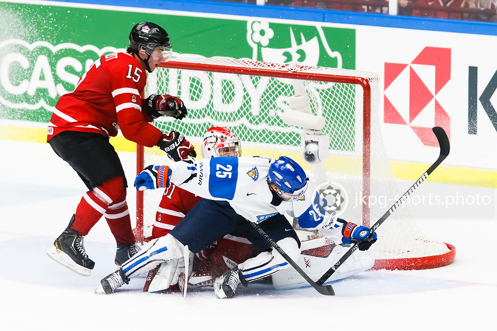 140104 Ishockey, JVM, Semifinal,  Kanada - Finland<br /> Icehockey, Junior World Cup, SF, Canada - Finland.<br /> Derrick Pouliot, (CAN), Zachary Fucale, (CAN), Henrik Haapala, (FIN). Hooking<br /> Endast f&ouml;r redaktionellt bruk.<br /> Editorial use only.<br /> &copy; Daniel Malmberg/Jkpg sports photo